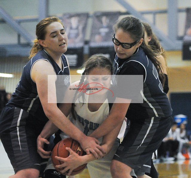 Chugiak's Kassidy Murfin is sandwiched by the Wolves' Hannah Yaw and Chyna Finley.  Photo for the Star by Michael Dinneen.