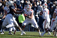 STATE COLLEGE, PA - NOVEMBER 10: Wisconsin C Tyler Biadasz (61) blocks Penn State DT P.J. Mustipher (93) as Wisconsin QB Jack Coan (17) drops back to pass during the Penn State Nittany Lions vs. the Wisconsin Badgers on November 10, 2018 at Beaver Stadium in State College, PA. (Photo by Randy Litzinger/Icon Sportswire)