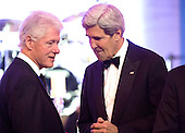 Former United States President Bill Clinton (L) talks to U.S. Secretary of State John Kerry during a dinner for Medal of Freedom awardees at the Smithsonian National Museum of American History on November 20, 2013 in Washington, D.C.<br /> Credit: Kevin Dietsch / Pool via CNP
