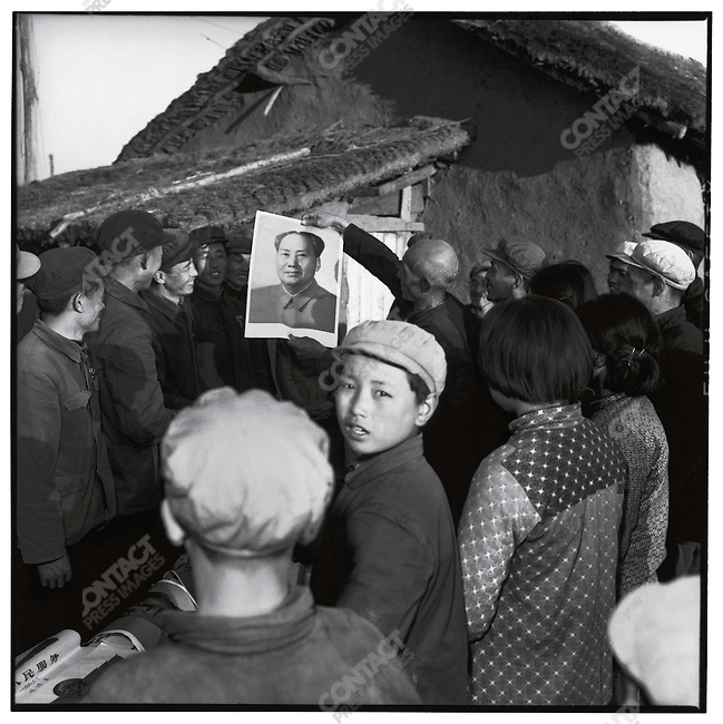 The mass produced Mao portraits displayed at the national conference are identical to the one a peasant from Acheng county exhibits to his neighbors. Acheng county, Heilongjiang province, 2 November 1966.