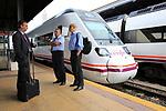 RENFE train at platform railway station with train staff, Merida, Extremadura, Spain