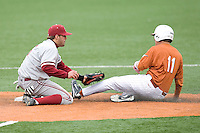 Stanford SS Jake Schandler applies the tag to Texas Lonhorn Brandon Loy (#11) at  UFCU Disch-Falk Field in Austin, Texas on Friday February 26th, 2100.  (Photo by Andrew Woolley / Four Seam Images)