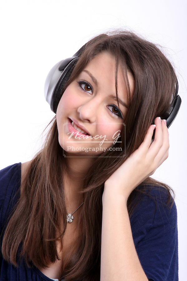 teenager girl teen young woman music headset headphone headphones listen listening hear enjoy enjoying sweet innocent cute adorable admire adolescence teenage celebrate embrace fun enjoyment excitement happiness happy smile imagination tenage person one youth innocence joy satisfaction share sharing cheerful adult preadult 18-20 eighteen human lady stereo child high school age feel musical passion musical hearing