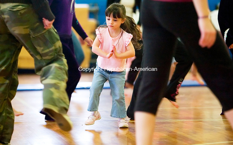 TORRINGTON, CT- 28 APRIL 07- 042807JT01-<br /> Shalyn Neary, 3, of Torrington, follows the steps of dance instructor Jennifer Breen from the Gaining Groundz Youth Project in New York City and other dancers from the Conn. Dance Theater in Watertown during Education Connection's Fitness Festival 2007, presented by Northwest Child and Family Health Council at the Torrington Armory on Saturday. The festival was simultaneous with the third annual John A. Ponte 5K Race at Fuessenich Park. The event, held in cooperation with the Charlotte Hungerford Hospital Cardiac Rehabilitation Center, was scheduled to coincide with National Storke Awareness Month.<br /> Josalee Thrift Republican-American