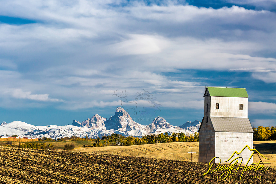 The Grand Tetons tower over the rolling farm fields of Teton Valley Idaho