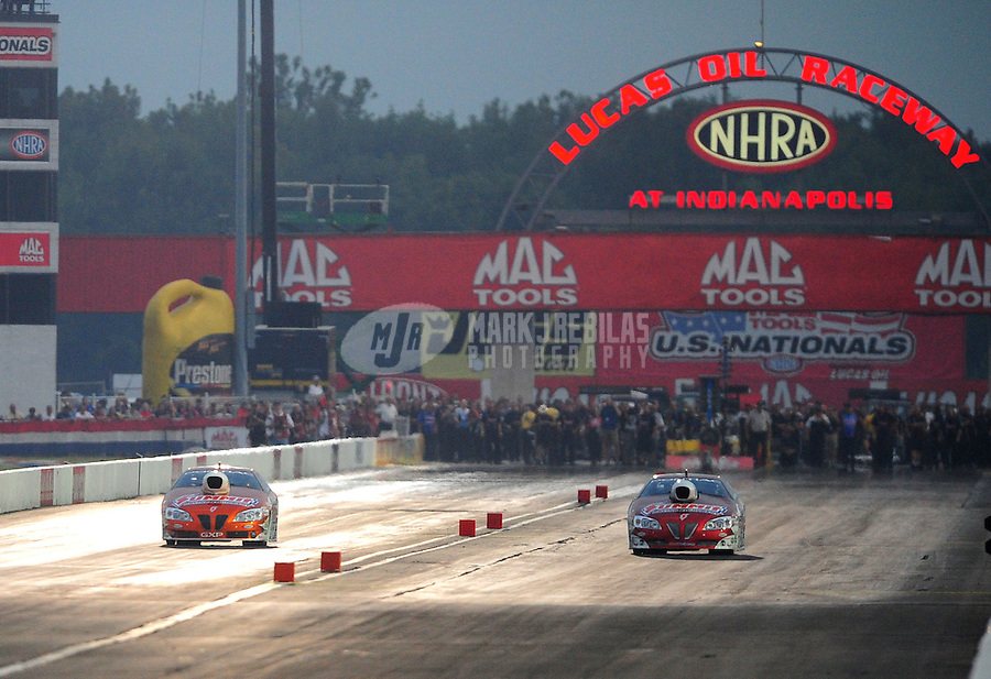 Sept. 3, 2011; Claremont, IN, USA: NHRA pro stock driver Jason Line (left) races alongside Greg Anderson during qualifying for the US Nationals at Lucas Oil Raceway. Mandatory Credit: Mark J. Rebilas-