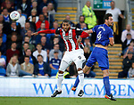Leon Clarke of Sheffield Utd and Sean Morrison of Cardiff City during the Championship match at the Cardiff City Stadium, Cardiff. Picture date: August 15th 2017. Picture credit should read: Simon Bellis/Sportimage