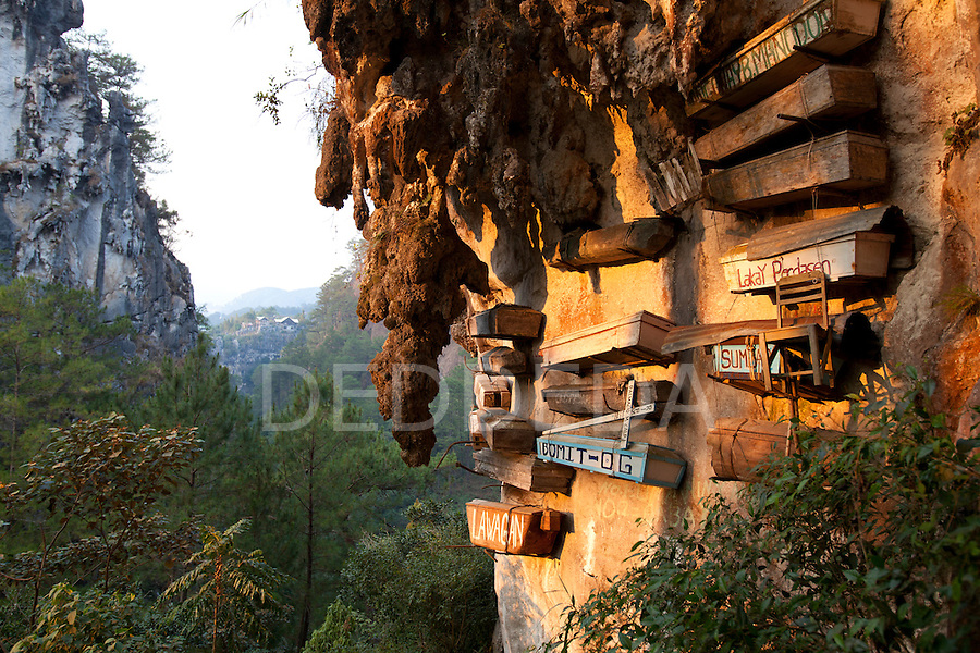The famous hanging coffins rest high on the limestone cliffs in Echo Valley near the mountain village of Sagada, in the Cordillera region of North Luzon, Philippines.