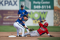Missoula Osprey shortstop Brandon Leyton (12) applies the tag to Livan Soto (7) on a stolen base attempt during a Pioneer League game against the Orem Owlz at Ogren Park Allegiance Field on August 19, 2018 in Missoula, Montana. The Missoula Osprey defeated the Orem Owlz by a score of 8-0. (Zachary Lucy/Four Seam Images)