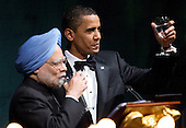 Washington, DC - November 24, 2009 -- United States President Barack Obama, right, and Manmohan Singh, India's prime minister, propose a toast during the State Dinner on the South Lawn of the White House in Washington, D.C., U.S., on Tuesday, November 24, 2009. Obama welcomed India's role as a rising and responsible global power, saying the U.S. will follow through on a civilian nuclear agreement and work to expand trade and investment ties with the world's largest democracy. .Credit: Andrew Harrer - Pool via CNP