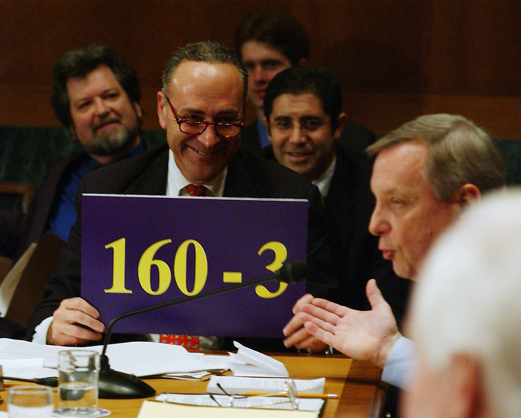 10/2/03.PICKERING NOMINATION--Sen. Charles E. Schumer, D-N.Y., holds up a sign for Sen. Richard J. Durbin, D-Ill., right, showing the number of judges approved versus the number blocked, during the Senate Judiciary business meeting to consider the nomination of Charles W. Pickering Sr. to be U.S. Circuit judge for the 5th Circuit. The committee endorsed the nomination with a 10-9 party-line vote, setting the stage for yet another Democrat filibuster over President Bush's judicial selections..CONGRESSIONAL QUARTERLY PHOTO BY SCOTT J. FERRELL