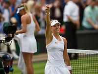 England, London, 28.06.2014. Tennis, Wimbledon, AELTC, Angelique Kerber (GER) defeats Sharapova (background) and celebrates<br /> Photo: Tennisimages/Henk Koster