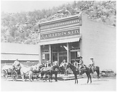 Two horsemen and freight wagon with driver and others in front of the J. J. Harris &amp; Co. store in Dolores.<br /> Dolores, CO