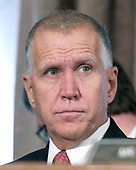 """United States Senator Thom Tillis (Republican of North Carolina) listens as Richard F. Smith, former Chairman and Chief Executive Officer, Equifax, Inc. gives testimony before the US Senate Committee on Banking, Housing, and Urban Affairs as they conduct a hearing entitled, """"An Examination of the Equifax Cybersecurity Breach"""" on Capitol Hill in Washington, DC on Tuesday, October 3, 2017. <br /> Credit: Ron Sachs / CNP"""