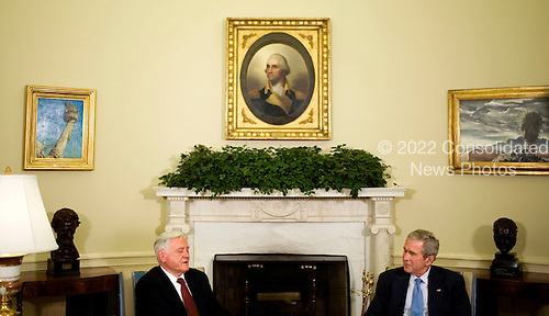 U.S. President George W. Bush meets with Valdas Adamkus, President of Lithuania, in the Oval Office of the White House in Washington, D.C., U.S., Monday, September 29, 2008.   .Credit: Joshua Roberts - Pool via CNP