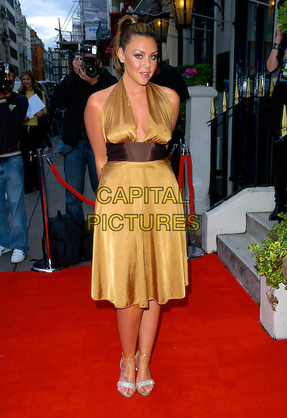 MICHELLE SCOTT-LEE.Arrives at The Dover Street Restaurant & Bar Charity Dinner, London, England, May 15th 2007..full length halterneck gold brown  dress bag tattoo on foot gold strappy sandals shoes Heaton Scott Lee.CAP/CAN.©Can Nguyen/Capital Pictures