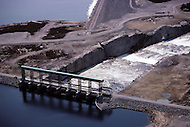 Quebec, Canada, February 1980.   The James Bay Project, a series of hydroelectric power stations on the La Grande River in northwestern Quebec, Canada, built by the state-owned utility Hydro-Quebec.  The project covers an area of the size of the State of New York and is one of the largest hydroelectric systems in the world, with a generating capacity of 16,527 megawatts. - Aerial view on the spillway of the Robert-Bourassa Dam.