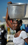 A woman in the Belair neighborhood of Port-au-Prince who survived Haiti's devastating January 12 earthquake carries safe water to her temporary shelter for the first time on January 21 after Norwegian Church Aid, a member of the ACT Alliance, installed a water system that provides homeless families in the ravaged neighborhood with piped in water points.