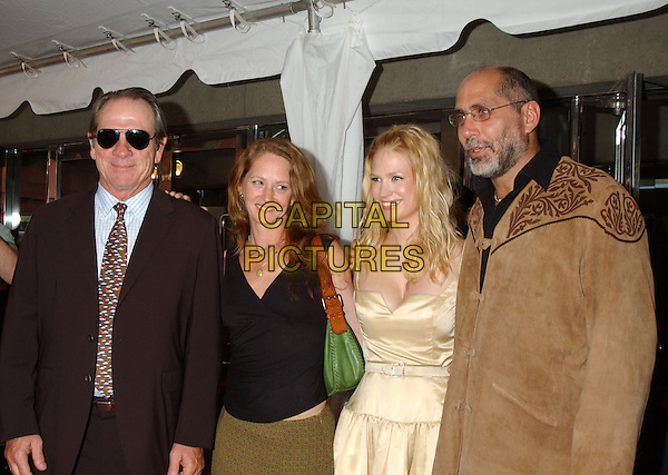 "TOMMY LEE JONES, MELISSA LEO, JANUARY JONES & GUILLERMO ARRIAGO.""The Three Burials of Melquiades Estrada"" Premiere at Roy Thompson Hall, The Toronto Film Festival,.Toronto, 11th September 2005.half length sunglasses black v-neck top gold dress tan brown suede coat.Ref: FARR.www.capitalpictures.com.sales@capitalpictures.com.© Capital Pictures."