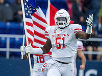 Annapolis, MD - OCT 8, 2016: Houston Cougars offensive lineman Na'Ty Rodgers (51) runs out with the flag before game between Houston and Navy at Navy-Marine Corps Memorial Stadium Annapolis, MD. The Midshipmen upset #6 Houston 46-40. (Photo by Phil Peters/Media Images International)
