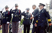 United States President Barack Obama walks past a police honor guard as he arrives to attend the National Peace Officers Memorial Service, an annual ceremony honoring law enforcement who were killed in the line of duty in the previous year, at the US Capitol in Washington, DC, May 15, 2015. <br /> Credit: Olivier Douliery / Pool via CNP