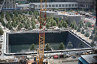 Tenth anniversary of 9/11.  Rebuilding at the World Trade Center site.  Footprint of the North Tower of the World Trade Center is part of the soon-to-be-completed 9/11 Memorial.  Photo by Ari Mintz.  8/10/2011.