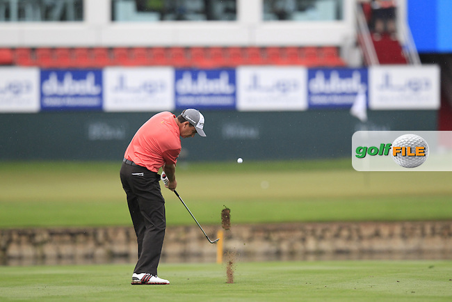 Peter Lawrie (IRL) plays his 3rd shot on the 18th hole during Saturday's Round 3 of the 2013 Omega Dubai Desert Classic held at the Emirates Golf Club, Dubai, 2nd February 2013..Photo Eoin Clarke/www.golffile.ie