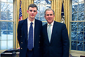 "Jordan Skittrail, prize winner in the U.S. - U.K. Millennium essay contest for the essay ""The Impact of the World War II Collaboration"" poses with United States President George W. Bush in the Oval Office of the White House in Washington, DC on February 22, 2001. <br /> Mandatory Credit: Paul Morse / White House via CNP"