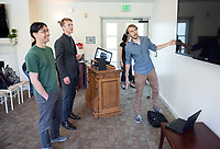 Shasta Clokey '18, Max Marion '18 and Justin Li, Assistant Professor, Cognitive Science.<br /> Occidental College's Computer Science Department hosts their first ever senior comps on April 13, 2018 in Morrison Lounge of the Johnson Student Center.<br /> (Photo by Marc Campos, Occidental College Photographer)