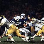Michigan 4<br /> <br /> BYU vs Michigan - Holiday Bowl and National Championship, San Diego, California (CA). 6 Robbie Bosco Quarterback.<br /> <br /> BYU-21<br /> Michigan-17<br /> <br /> December 23, 1984<br /> <br /> Photo by: Mark Philbrick/BYU<br /> <br /> Copyright BYU PHOTO 2008<br /> All Rights Reserved<br /> 801-422-7322<br /> photo@byu.edu