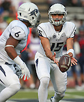 Nevada quarterback Tyler Stewart (15) pitches to running back Don Jackson (6) while playing against Arizona during the first half of an NCAA college football game in Reno, Nev. on Saturday, Sept. 12, 2015. (AP Photo/Cathleen Allison)