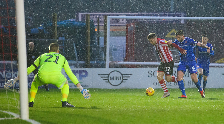 Lincoln City's Shay McCartan is fouled by Morecambe's Alex Kenyon, winning his side a penalty<br /> <br /> Photographer Chris Vaughan/CameraSport<br /> <br /> The EFL Sky Bet League Two - Saturday 15th December 2018 - Lincoln City v Morecambe - Sincil Bank - Lincoln<br /> <br /> World Copyright © 2018 CameraSport. All rights reserved. 43 Linden Ave. Countesthorpe. Leicester. England. LE8 5PG - Tel: +44 (0) 116 277 4147 - admin@camerasport.com - www.camerasport.com