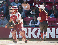 NWA Democrat-Gazette/CHARLIE KAIJO An Arkansas Razorbacks player scores during a softball match, Sunday, October 28, 2018 at Bogle Park, University of Arkansas in Fayetteville.<br />