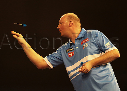 29.12.2015. Alexandra Palace, London, England. William Hill PDC World Darts Championship. Vincent van der Voort throws