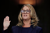 Professor Christine Blasey Ford, who accused U.S. Supreme Court nominee Brett Kavanaugh of a sexual assault in 1982, is sworn in to testify before a Senate Judiciary Committee confirmation hearing for Kavanaugh on Capitol Hill in Washington, U.S., September 27, 2018. REUTERS/Jim Bourg