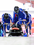19 December 2010: Alexey Gorlachev leads his 4-Man Bobsled team in the push-off, taking 9th place for Russia at the Viessmann FIBT World Cup Championships on Mount Van Hoevenberg in Lake Placid, New York, USA. Mandatory Credit: Ed Wolfstein Photo