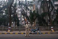 Security officer mans position along course of 2010 Mumbai Cyclothon mass ride - Bombay/Mumbai - India