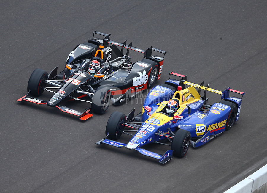May 29, 2016; Indianapolis, IN, USA; IndyCar Series driver Alexander Rossi (right) alongside Alex Tagliani during the 100th running of the Indianapolis 500 at Indianapolis Motor Speedway. Mandatory Credit: Mark J. Rebilas-USA TODAY Sports