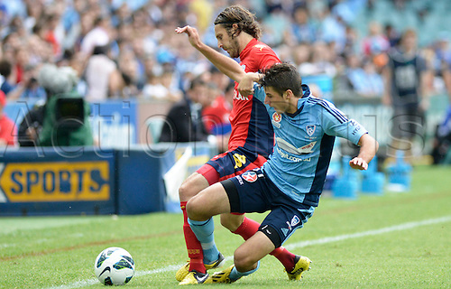 16.02.2013 Sydney, Australia. Sydney midfielder Terry Antonis  and Adelaide defender Jon McKain in action during the Hyundai A League game between Sydney FC and Adelaide United from the Allianz Stadium.