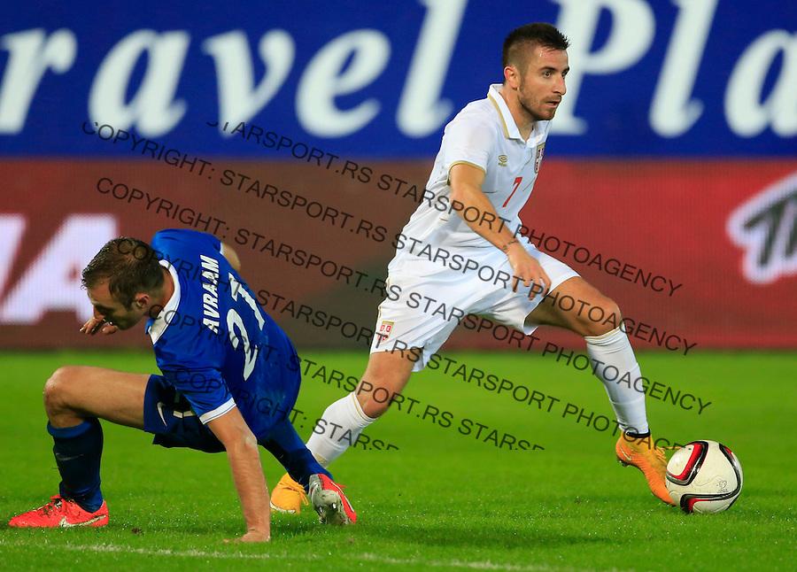 Fudbal<br /> Prijateljski mec-Friendly match<br /> Srbija v Grcka<br /> Zoran Tosic (R) and Avraam Papadopoulos<br /> Chania, 17.11.2014.<br /> foto: Srdjan Stevanovic/Starsportphoto &copy;