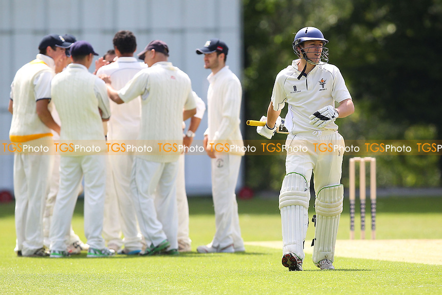 Kishen Velani of Wanstead claims the second Chingford wicket - Wanstead CC vs Chingford CC - Essex Cricket League at Overton Drive - 10/05/14 - MANDATORY CREDIT: Gavin Ellis/TGSPHOTO - Self billing applies where appropriate - 0845 094 6026 - contact@tgsphoto.co.uk - NO UNPAID USE