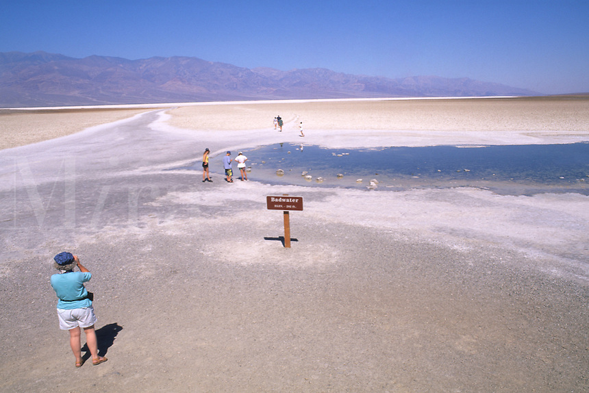Tourist in Death Valley California lowest point in United States 282 feet below sea level in dry deser