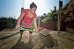 Bhagwati Tamang mixes mortar to use in laying bricks in Jogimara, a village in the Dhading District of Nepal where Dan Church Aid, a member of the ACT Alliance, has provided a variety of support to local villagers in the wake of a devastating 2015 earthquake. Tamang, an experienced mason, has helped the ACT Alliance train other carpenters and masons in the community so they'll be ready to help construct permanent housing once the Nepali government begins to disburse funds.