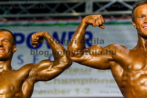 Competitors pose during the IFBB Junior & Master Body Building World Championships, held at Budakalasz City Sports Hall.