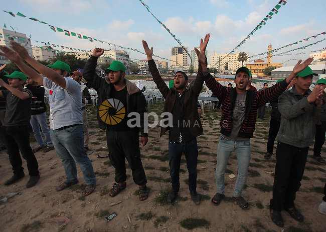 Palestinian Youths shout slogans during the preparation of the Hamas festival in Gaza City, March 22, 2014. Hamas organized a festival in the anniversary of the death of Hamas leaders Sheikh Ahmed Yassin, Ibrahim Makadmeh, and Abdul Aziz Rantisi. Photo by Ashraf Amra