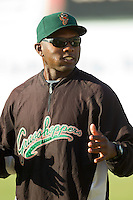Greensboro Grasshoppers hitting coach Frank Moore (24) talks to the team prior to the South Atlantic League game against the Kannapolis Intimidators at CMC-Northeast Stadium on July 15, 2013 in Kannapolis, North Carolina.  The Intimidators defeated the Grasshoppers 4-0.   (Brian Westerholt/Four Seam Images)