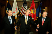 """United States President George W. Bush, makes a brief statement to the press following his meeting at the Pentagon in Washington, D.C. on January 13, 2005.  United States Vice President Dick Cheney, right, and United States Secretary of Defense Donald Rumsfeld, left, looked on as the President spoke.  In his remarks, the President said """"There's a lot of talk about how some in the world don't appreciate America.  Well, I can assure you those who have been helped by our military appreciate America.""""<br /> Credit: Jay L. Clendenin / Pool via CNP"""