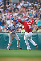 Scranton/Wilkes-Barre RailRiders shortstop Nick Noonan (21) tags Daric Barton (3) in a run down during a game against the Buffalo Bisons on June 10, 2015 at Coca-Cola Field in Buffalo, New York.  Scranton/Wilkes-Barre defeated Buffalo 7-2.  (Mike Janes/Four Seam Images)