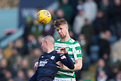17th March 2019, Dens Park, Dundee, Scotland; Ladbrokes Premiership football, Dundee versus Celtic; Kristoffer Ajer of Celtic climbs high in the air to win the header over Kenny Miller of Dundee