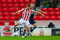 11th January 2020; Bet365 Stadium, Stoke, Staffordshire, England; English Championship Football, Stoke City versus Milwall FC; Sam Vokes of Stoke City under pressure from Matt Smith of Millwall - Strictly Editorial Use Only. No use with unauthorized audio, video, data, fixture lists, club/league logos or 'live' services. Online in-match use limited to 120 images, no video emulation. No use in betting, games or single club/league/player publications
